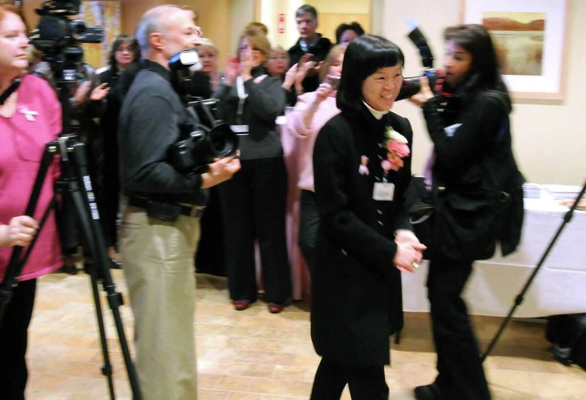 Griffin Hospital in Derby officially opened its Center for Breast Wellness. The Center's medical director Dr. Zandra Cheng with corsage is introduced and walks to the podium to speak. Photo by Mara Lavitt/New Haven Register1/10/11