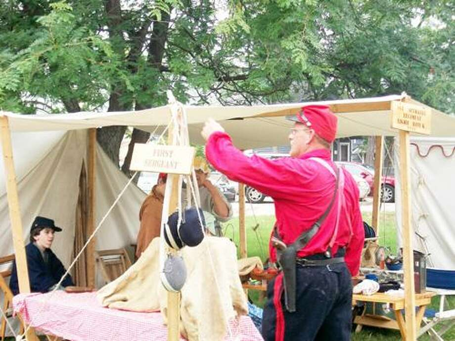 Photo Special to the Dispatch by JEN ARMSTRONG  A reenacter prepares for a battle at the Battle on the Beach at Sylvan Beach on Saturday, Sept. 3, 2011.