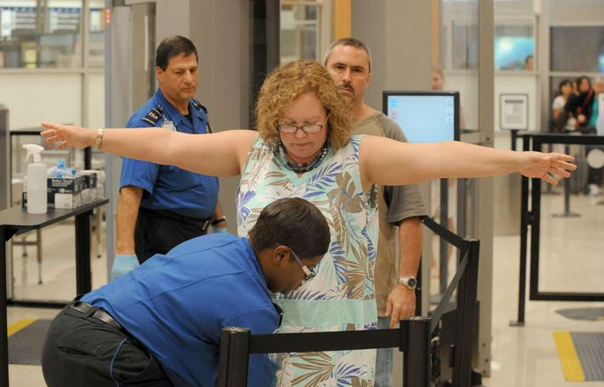 In this Aug. 3, 2011, photo, airline passengers go through the Transportation Security Administration checkpoint at Hartsfield-Jackson Atlanta International Airport in Atlanta. The TSA was created after the terrorist attacks of Sept. 11, 2001. (AP Photo/Erik S. Lesser)