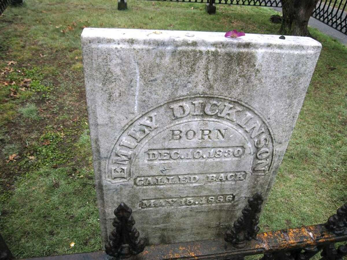 This April 23, 2011, photo shows the tombstone in West Cemetery in Amherst, Mass., marking the grave of the reclusive 19th century poet Emily Dickinson, who lived and died in a house nearby that is now a museum. The gravestone reads,