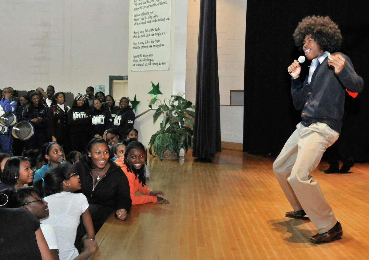 NEW HAVEN-Seventh and eighth grade girls at Edgewood School get an up close view of Hillhouse scholar athlete, Andre Sutton. Sutton was portraying Michael Jackson. The performance was part of a Connecticut Mastery Test pep rally held at Edgewood. Students from Hillhouse visited to inspire the younger students and talk to them about hard work and determination. Melanie Stengel/Register