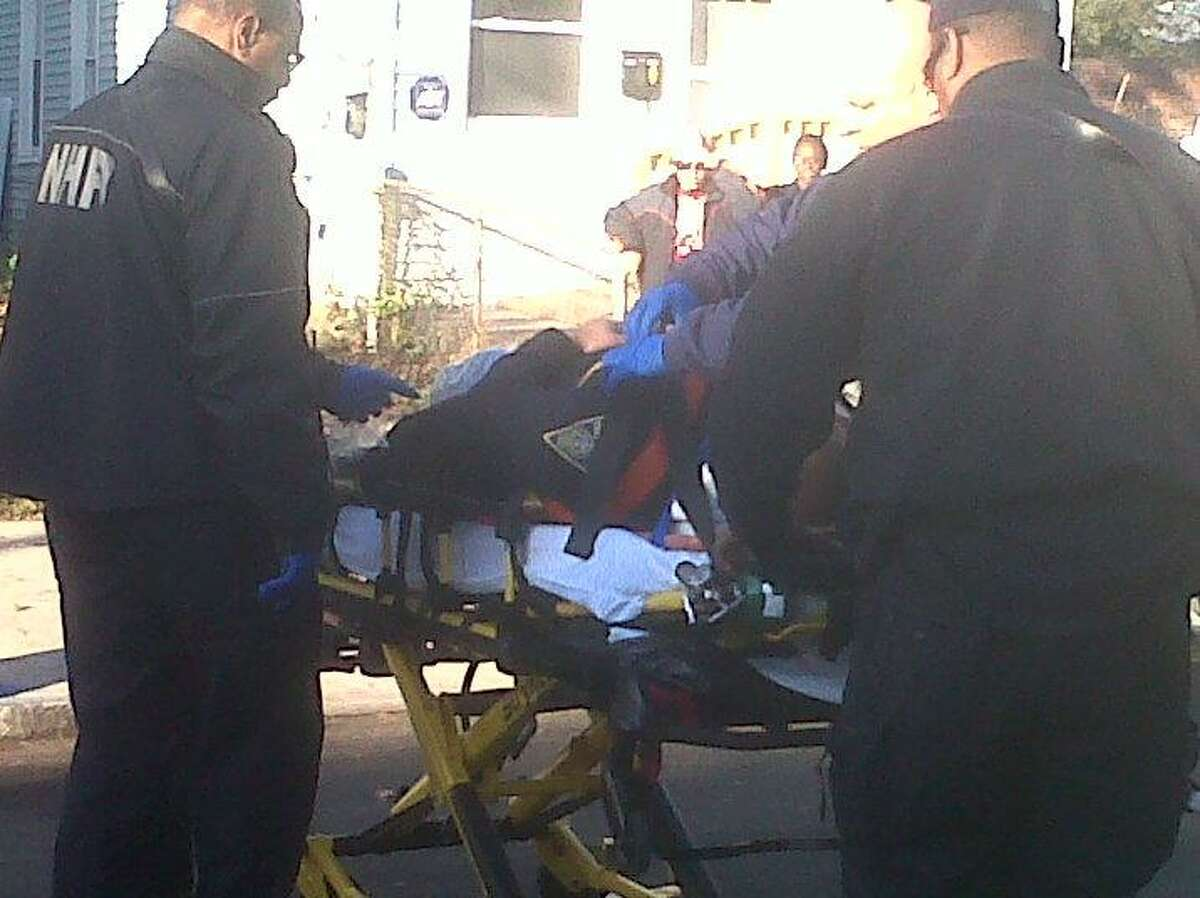 Emergency workers tend to injured officer. William Kaempffer/Register