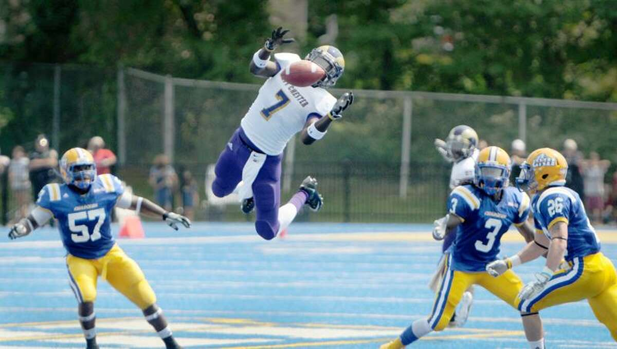 West Chester wide receiver Lee LaRonn leaps above University of New Haven defenders (L-R) Charlie Hatchett, Kendrick Butler and J.D. Chalifoux as he attempts a pass reception during first quarter action at the University of New Haven 9/3/11. Photo by Peter Hvizdak / New Haven Register September 3, 2011 ph2356 Connecticut
