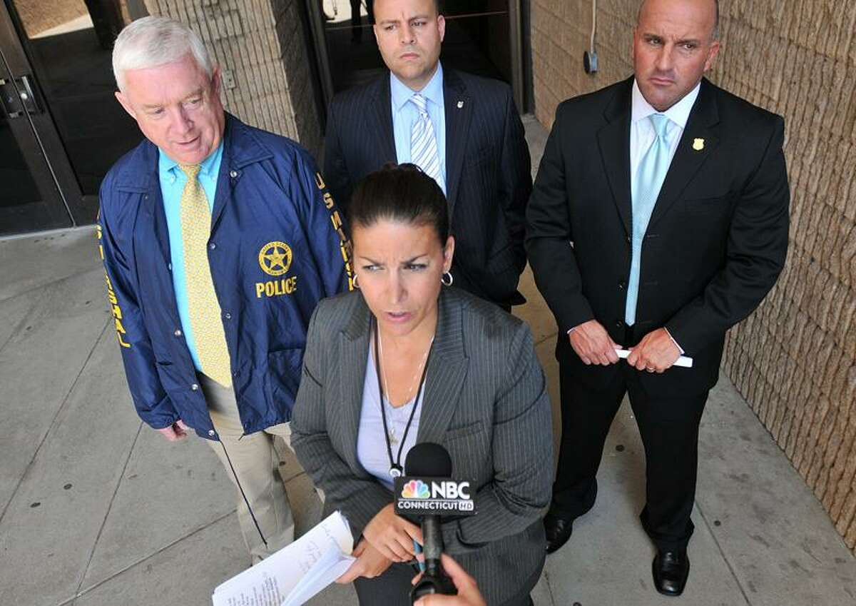 New Haven--New Haven Police Special Investigations Unit Lt. Julie Johnson speaks about the arrest of a suspect in connection to January's Front Street double homicide. Photo by Brad Horrigan/New Haven Register-07.01.11.