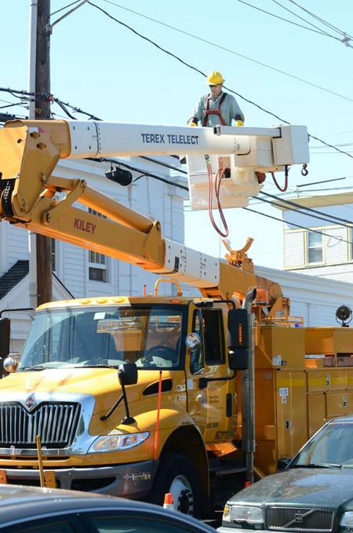 A Connecticut Light & Power crew works on power lines last week following Hurricane Irene. VM Williams/Register