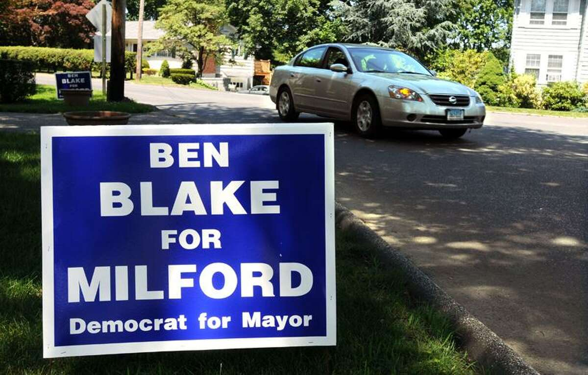 Political signs have popped up in Milford despite a city ordinance prohibiting them more than 90 days before an election. Mara Lavitt/Register