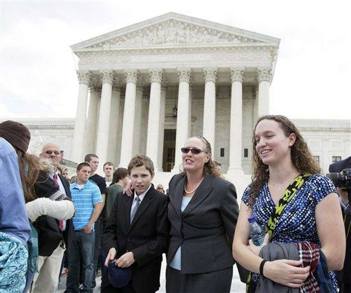 In this Oct. 6, 2010, file photo, Margie Phelps, second from right, a daughter of Fred Phelps, and the lawyer who argued the case for of the Westboro Baptist Church of Tokepa Kan., walks from the Supreme Court, in Washington. The Supreme Court has ruled that the First Amendment protects fundamentalist church members who mount attention-getting, anti-gay protests outside military funerals. (AP Photo)