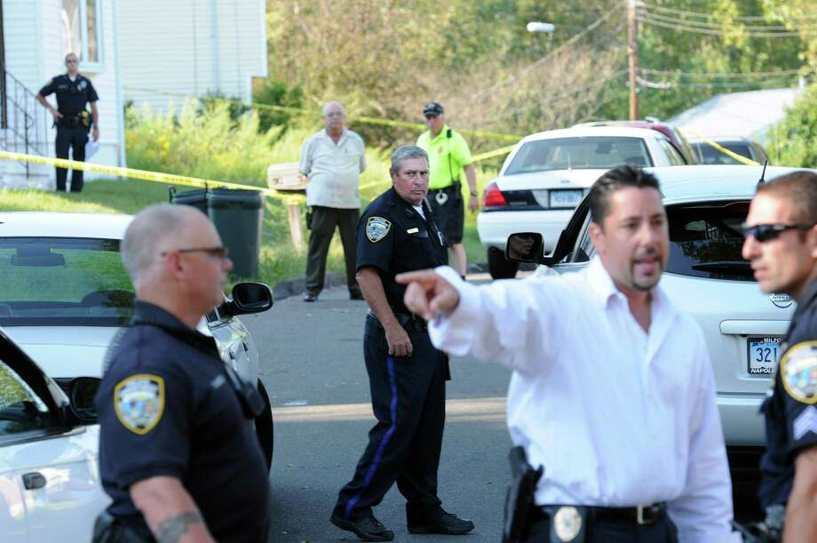 West Haven--West Haven police investigate a shooting along Rockdale Road in West Haven. (Editors note-- The exact number of house that police tape was surrounding was thought to be 90, but this is UNCONFIRMED).  Peter Casolino/New Haven Register9/02/11