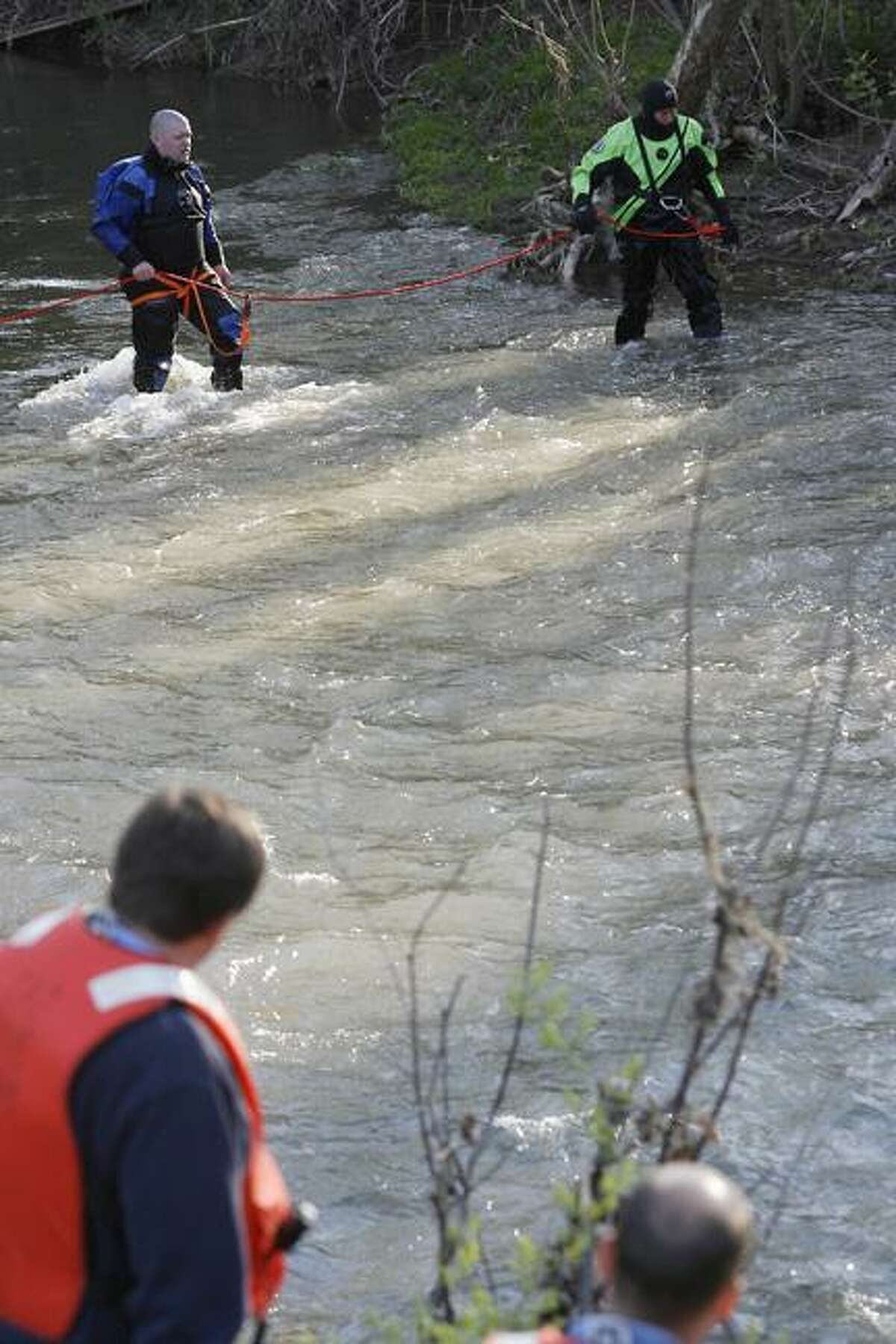 Dispatch Staff Photo by JOHN HAEGERRescue Diver crews search a section of Oneida Creek at the Madison Oneida County line in Kenwood on Thursday, May 5, 2011.
