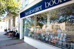 Breakwater Books on the Guilford Green was shut tight while people were able to buy lunch right next door at Cilantos. (VM Williams/Register)