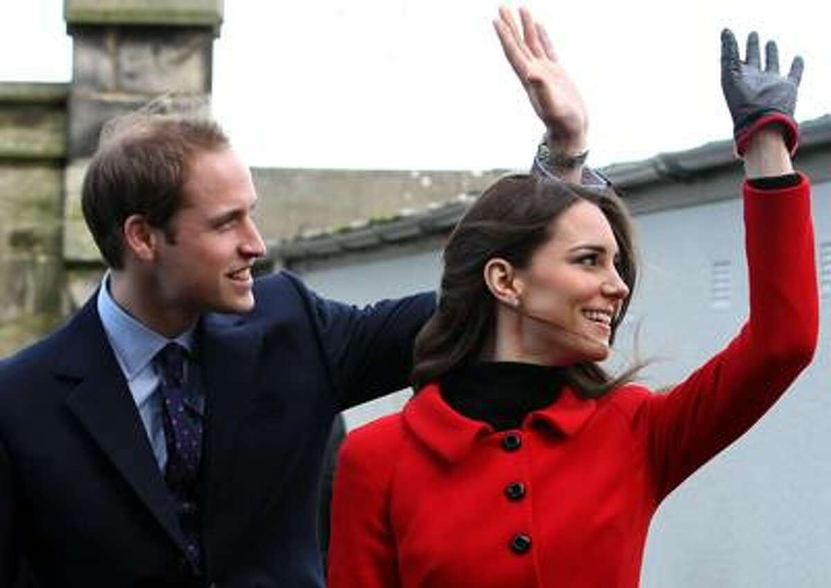 Phil Noble/Associated Press photo: Those who can't get enough about Britain's royal couple, Prince William and his fiancee, Kate Middleton, shown here during a visit to the University of St. Andrews, where they met, can follow the planning for the big day on the couple's new website: www.officialroyalwedding2011.org.