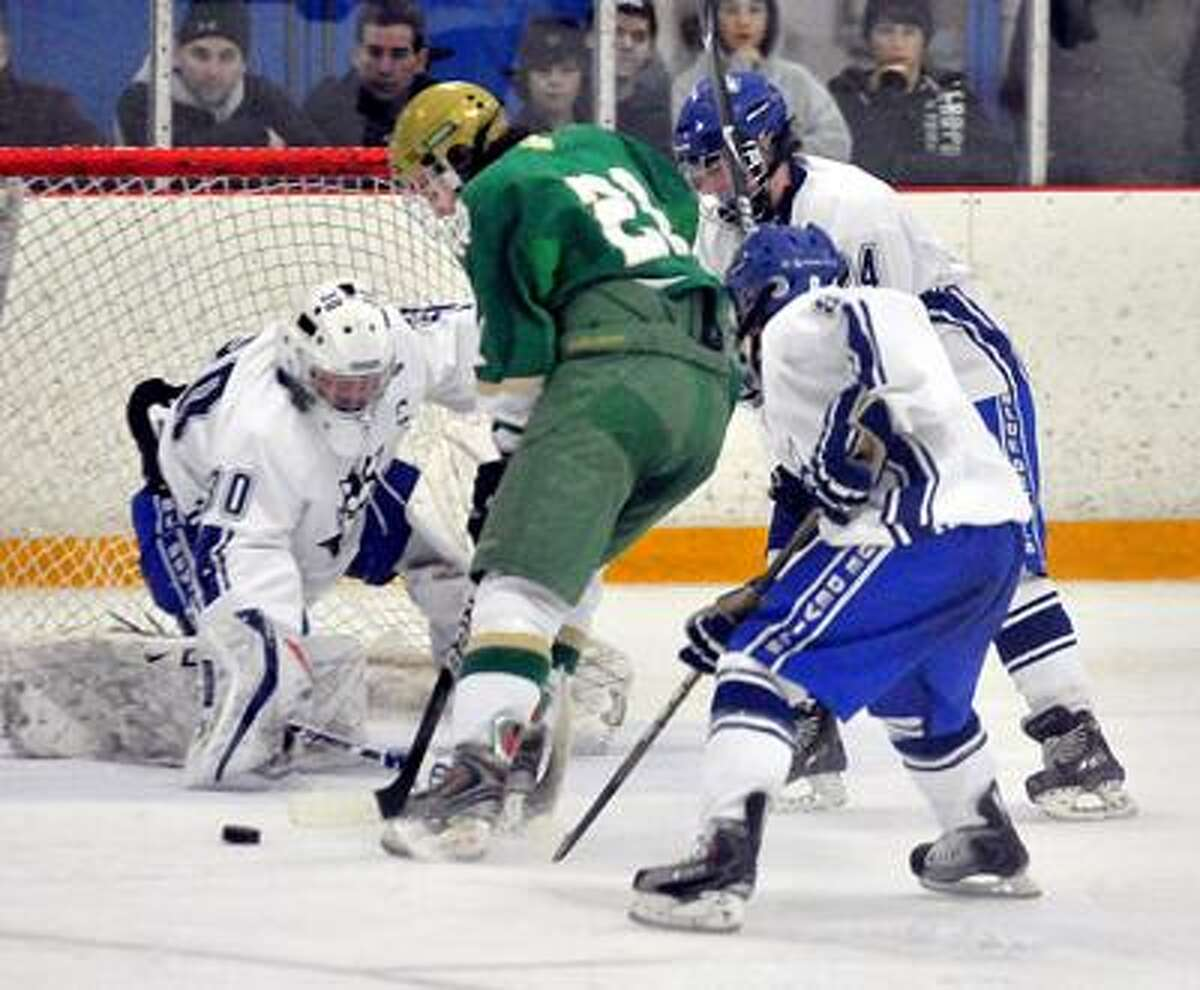 WEST HAVEN SPORTS_____West Hven goalie J.P. Withington is unable to stop Notre Dame's Kyle Thibault from scoring in 2nd period action. Melanie Stengel/Register