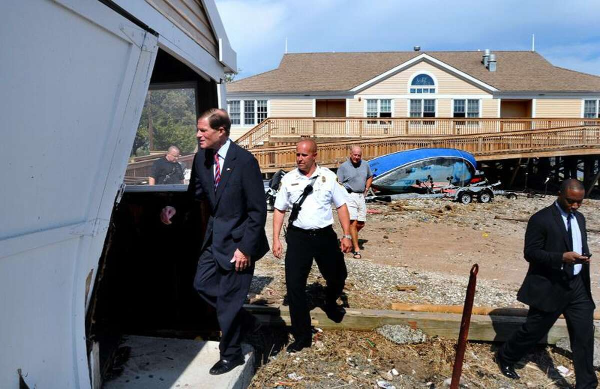U.S. Sen. Richard Blumenthal, D-Conn., left, tours damage at Sound School in New Haven Wednesday, escorted by New Haven Fire Department Assistant Chief Patrick Egan. Arnold Gold/Register