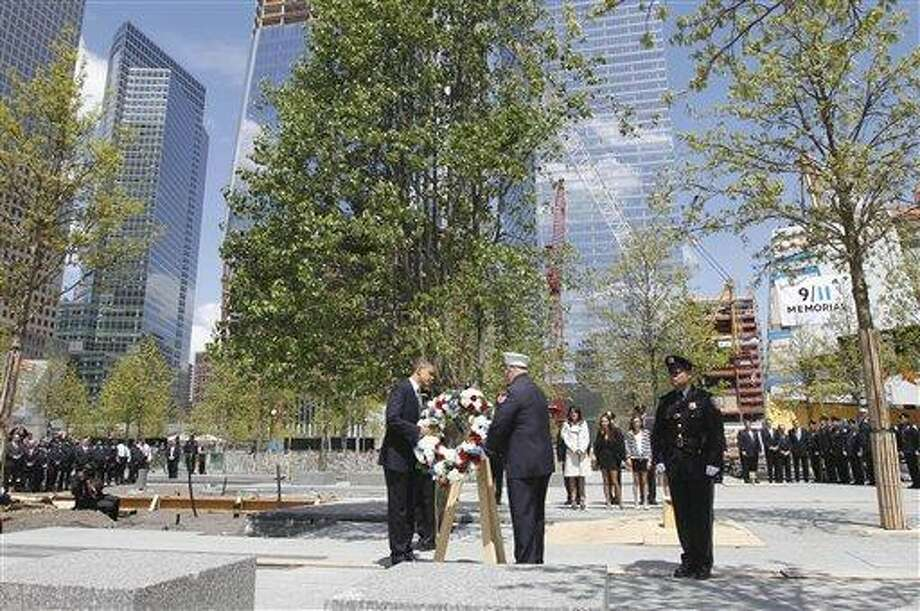 President Barack Obama lays a wreath at the National Sept. 11 Memorial at Ground Zero in New York. (AP Photo) Photo: AP / AP