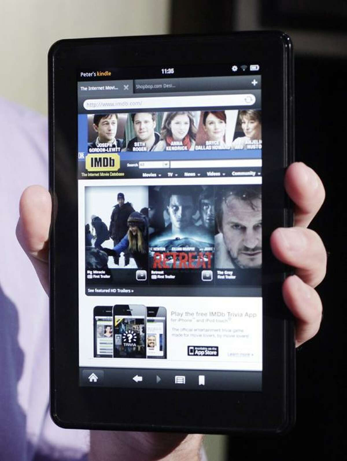 A man holds the Kindle Fire in New York. Online retailer Amazon said that the 2011 holiday season was its ever for its Kindle-brand e-readers and tablet computers. (Associated Press)