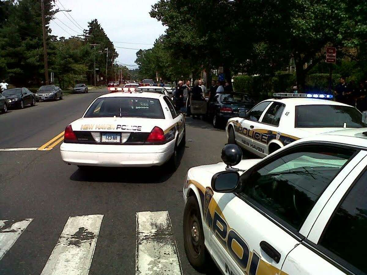 Police at scene where a man was stopped in connection with a Maryland case Photo by William Kaempffer