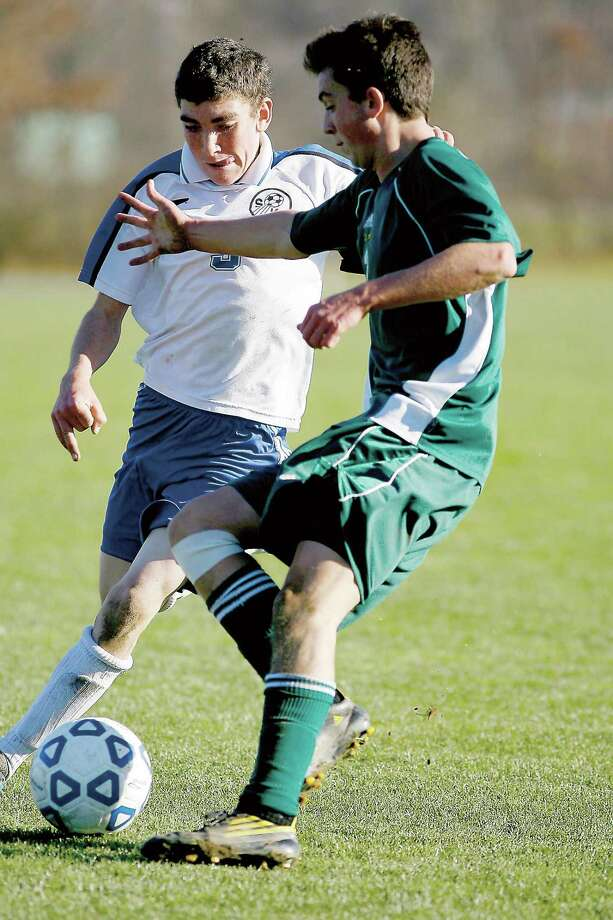 Dispatch File Photo by JOHN HAEGER Hamilton's Drew Thompson, right, and South Kontright's Jesse Beest (3) battle for the ball during the NYSPHAA Regional in Oneonta on Nov. 13, 2010.