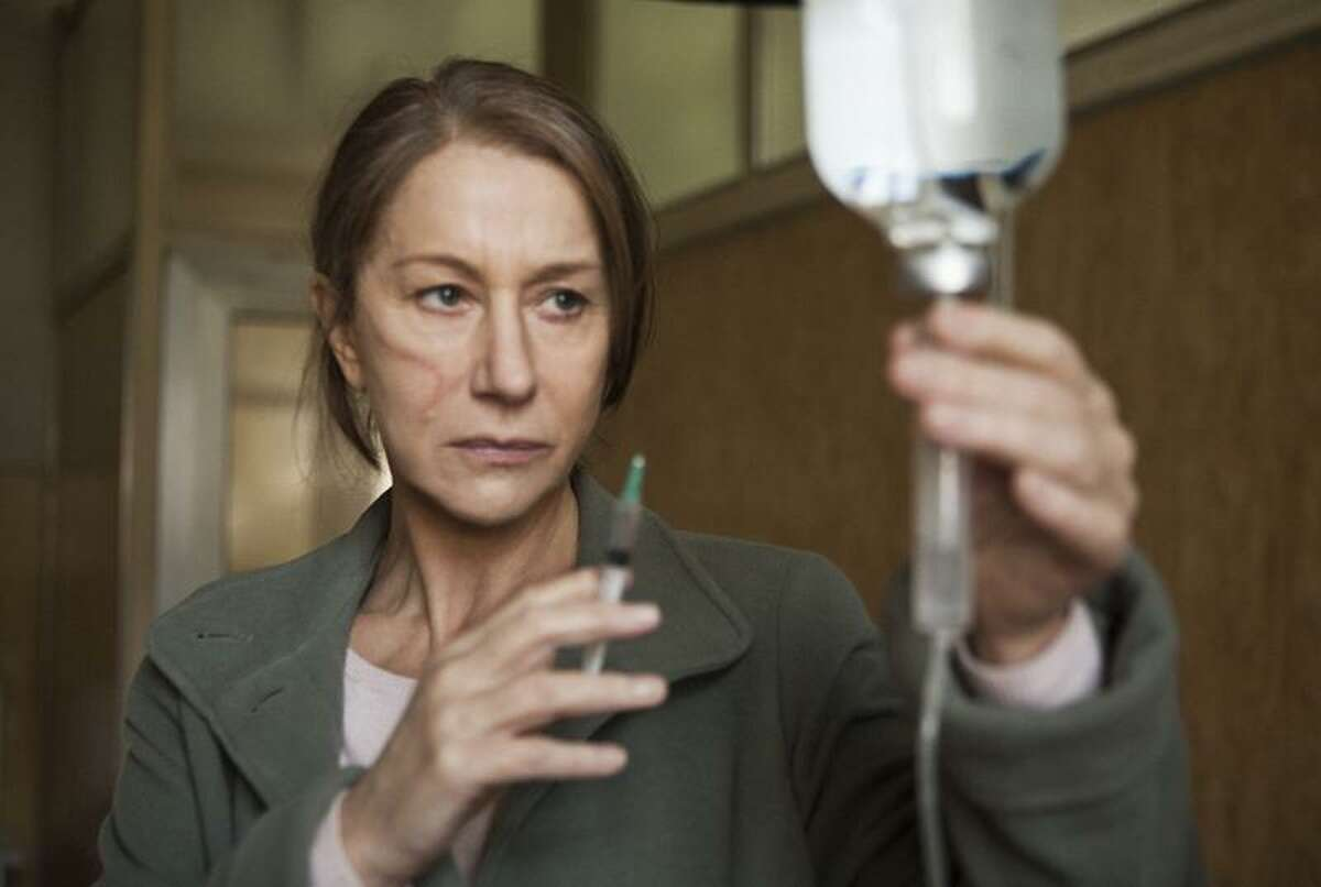 In this film image released by Focus Features, Helen Mirren is shown in a scene from the espionage thriller