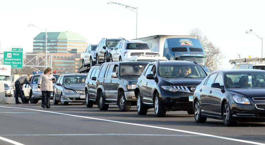A five-car fender-bender on Interstate 95 at exit 46 backed up traffic over the Pearl Harbor Memorial  Bridge in New Haven this morning. VMWilliams/Register.