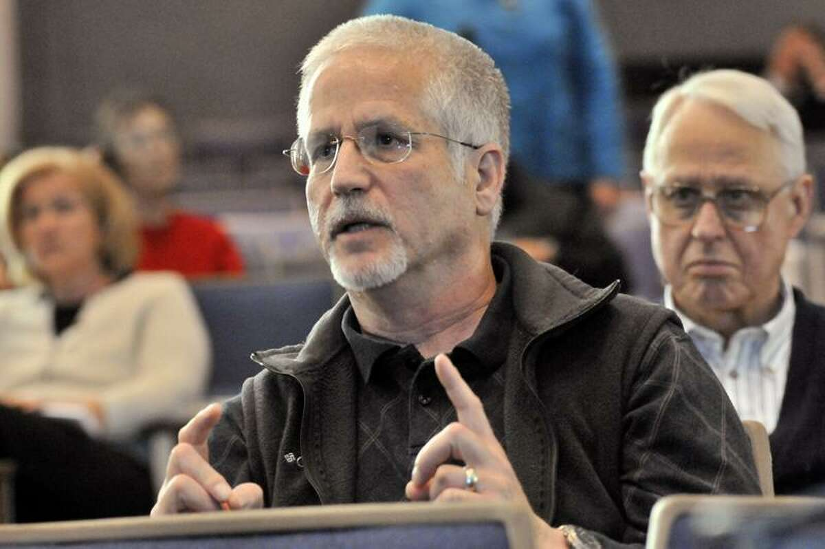 Barry Felson of Guilford asks a question during a meeting to discuss the proposal to build a new high school. The meeting was held in Guilford High School. (Melanie Stengel/Register)