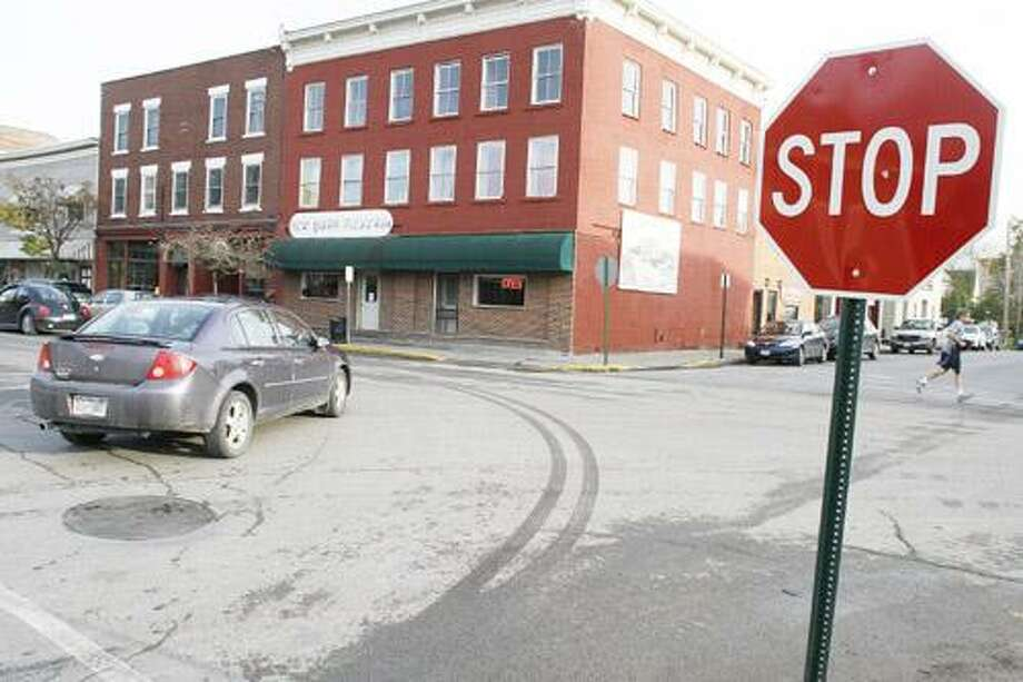 Photo by JOHN HAEGER (Twitter.com/OneidaPhoto) A car turns east onto Lebanon Street from Maple in the Village of Hamilton on Friday, Oct. 28, 2011. In the spring, the intersection will be changed to a four-way stop.
