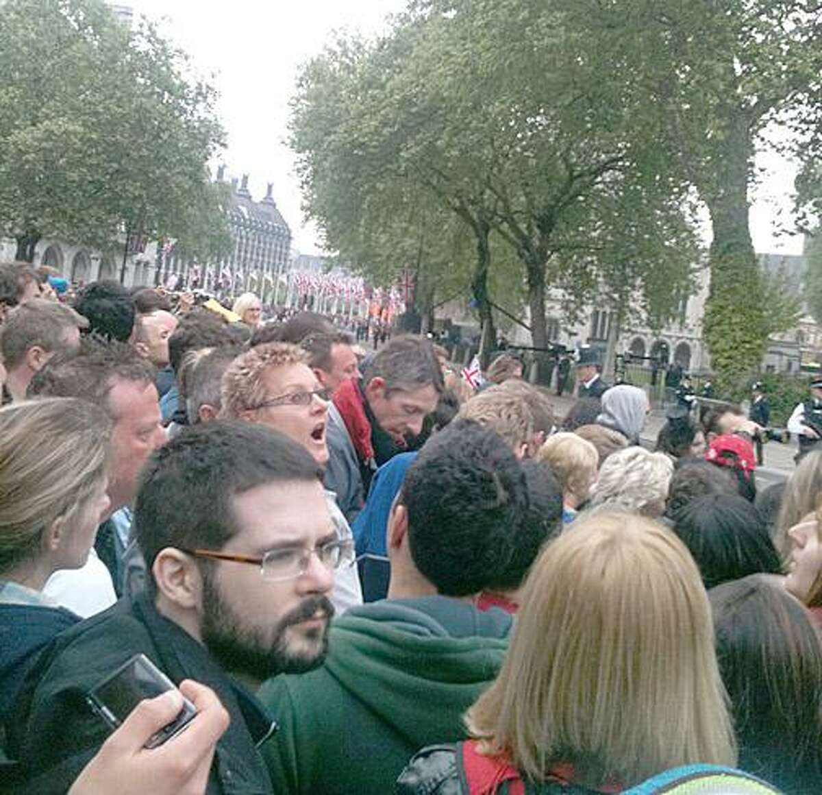 The crowd stands shoulder-to-shoulder on the streets of London. -Photo by By Carol Hennessy