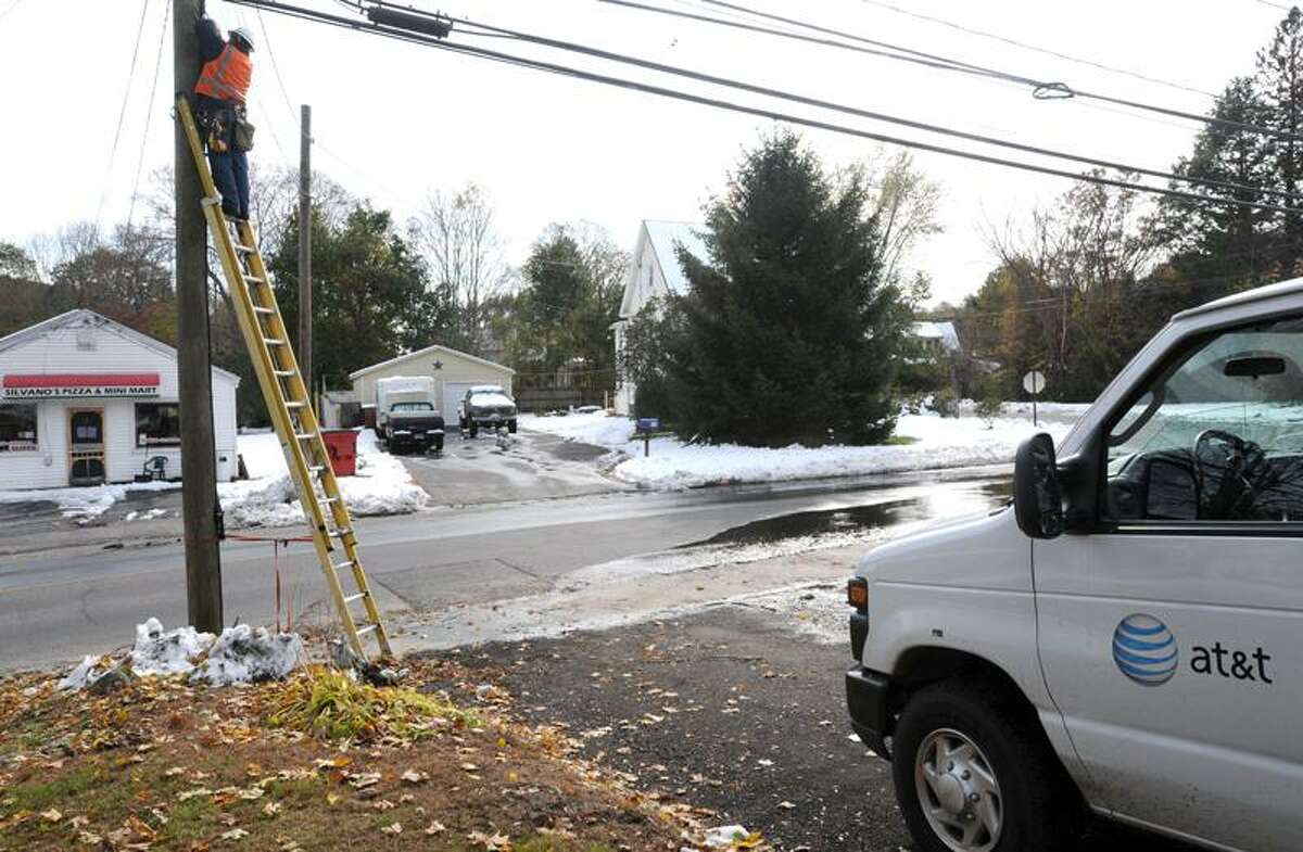 An AT&T lineman repairs a phone line Monday along Bungay Road in Seymour. (Mara Lavitt/Register)