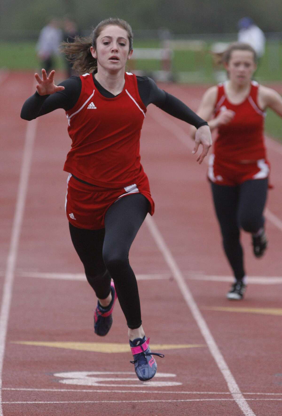 Dispatch Staff Photo by JOHN HAEGERVVS Maggie Curtis cross the finish line to win the 100 meter dash in a meet against Clinton on Wednesday, May 4, 2011 at VVS.
