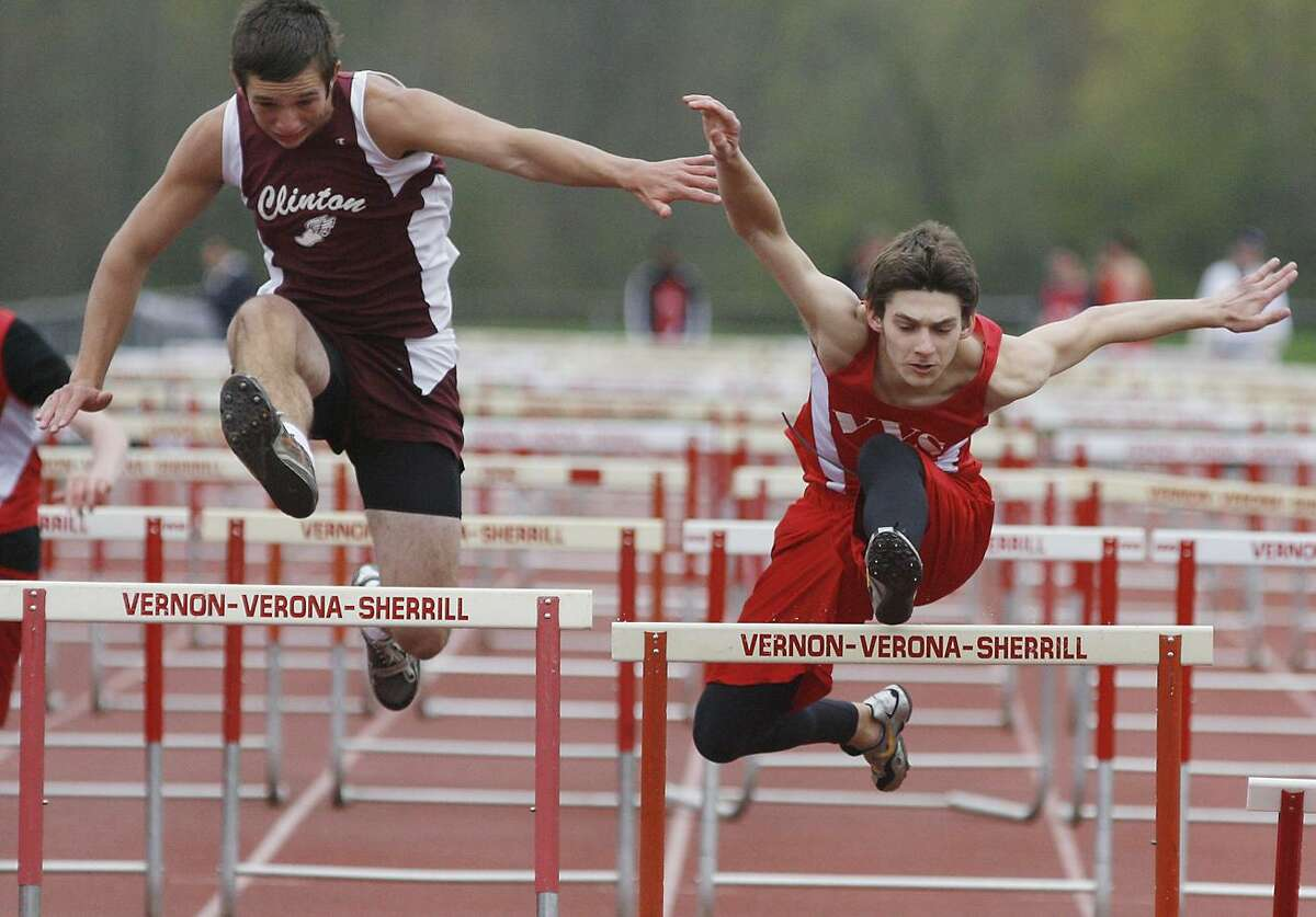 Dispatch Staff Photo by JOHN HAEGERClinton's Devin Cornelius and VVS Nathan Dugan battle it out for second in the 100 high hurdles on Wednesday, May 4, 2011 at VVS. Dugan placed second followed by Cornelius for third.