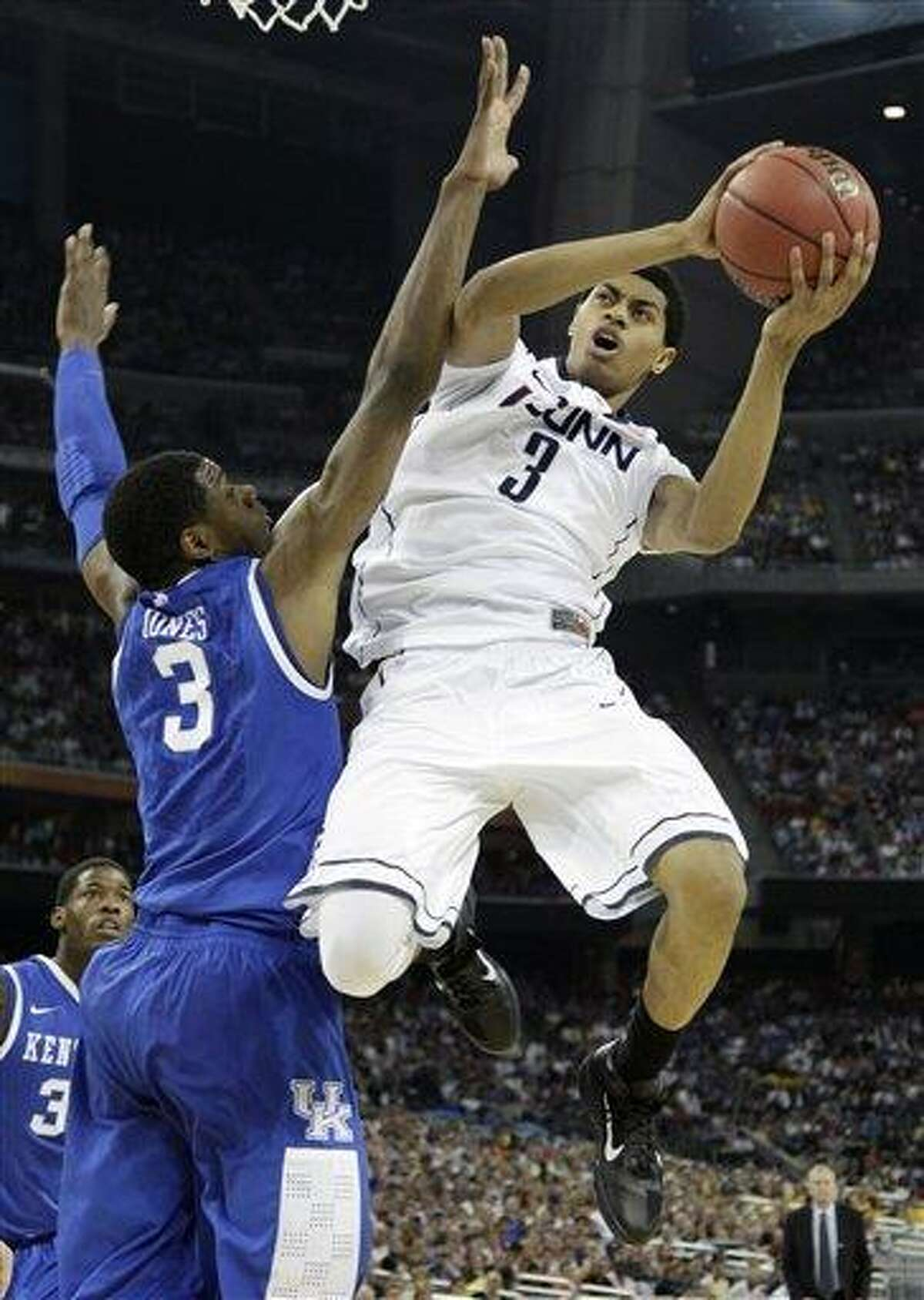 FIEL - In this April 2, 2011 file photo, Connecticut's Jeremy Lamb, right, looks to shoot over Kentucky's Terrence Jones, left, during the first half of a men's NCAA Final Four semifinal college basketball game, in Houston. Lamb was selected to The Associated Press' preseason All-American team this season. (AP Photo/David J. Phillip, File)