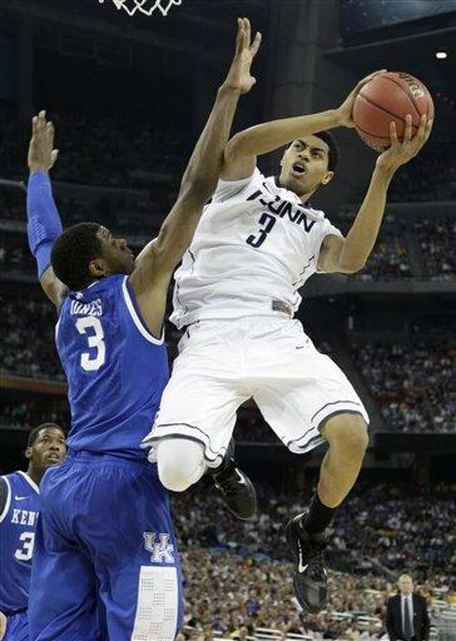 FIEL - In this April 2, 2011 file photo, Connecticut's Jeremy Lamb, right, looks to shoot over Kentucky's Terrence Jones, left, during the first half of a men's NCAA Final Four semifinal college basketball game, in Houston. Lamb was selected to The Associated Press' preseason All-American team this season. (AP Photo/David J. Phillip, File) Photo: AP / AP2011