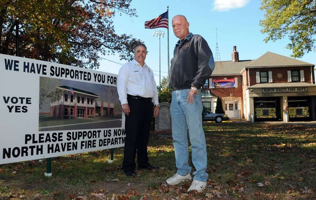 Fire Chief Vincent Landisio, left, and Firefighter Ray Prunier stand outside the Quinnipiac Avenue firehouse in North Haven. All the Fire Department buildings need renovation or rebuilding. Photo by Mara Lavitt/New Haven Register
