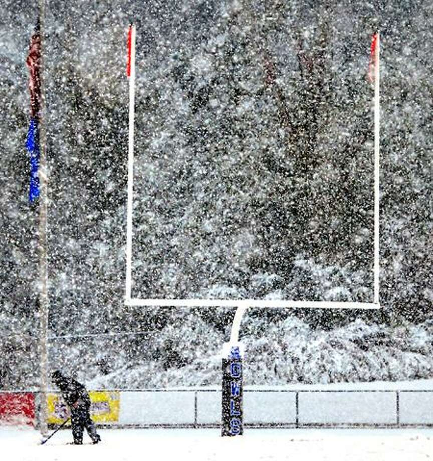 Saturday's snowstorm created numerous problems for athletic teams -- as shown by this picture of Southern Connecticut State's football field -- but even now the lingering aftereffects of the snow are creating headches for high school programs across the state. (Arnold Gold/Register)