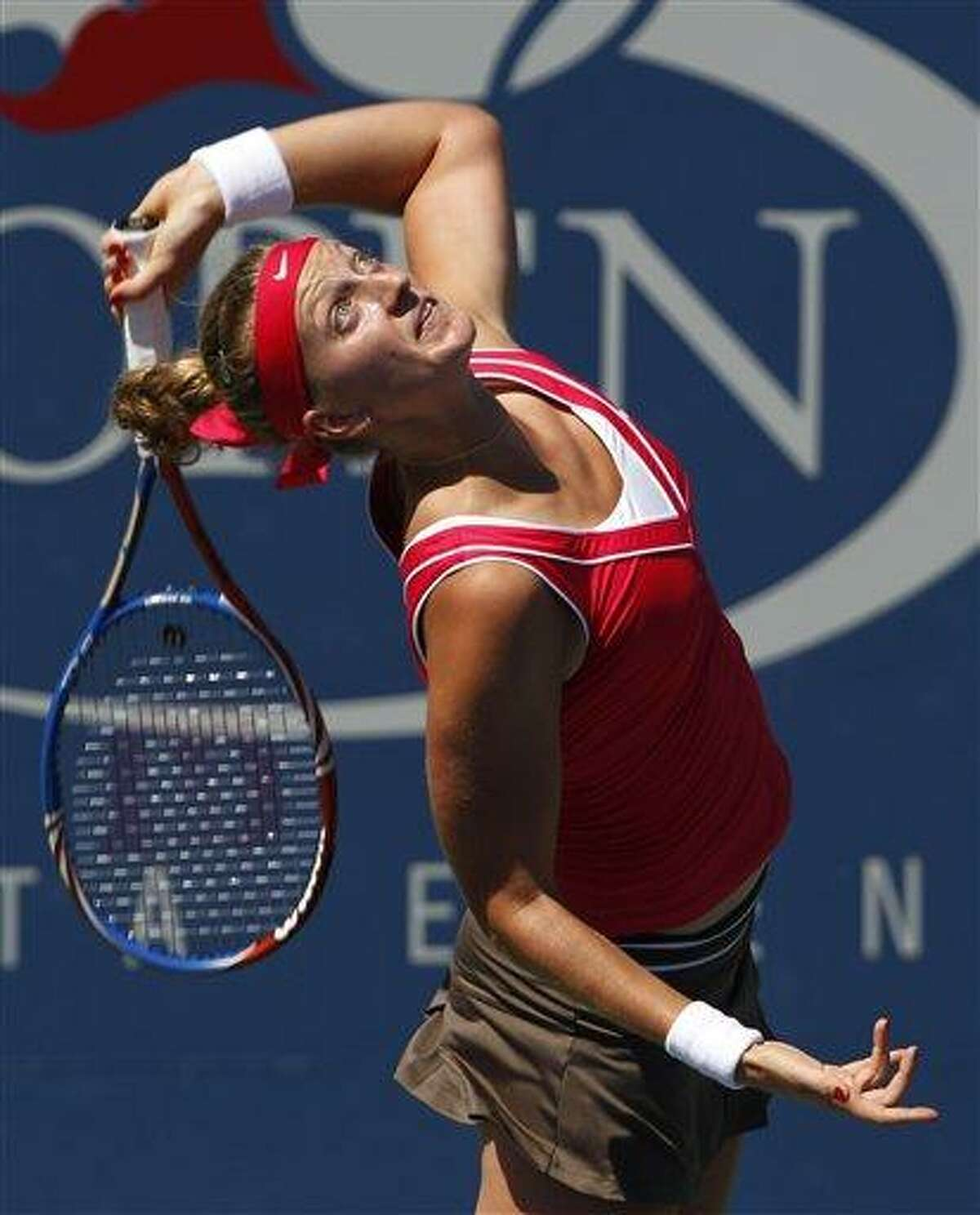 Petra Kvitova of the Czech Republic returns a shot to Alexandra Dulgheru of Romania during the first round of the U.S. Open tennis tournament in New York, Monday, Aug. 29, 2011. (AP Photo/Elise Amendola)
