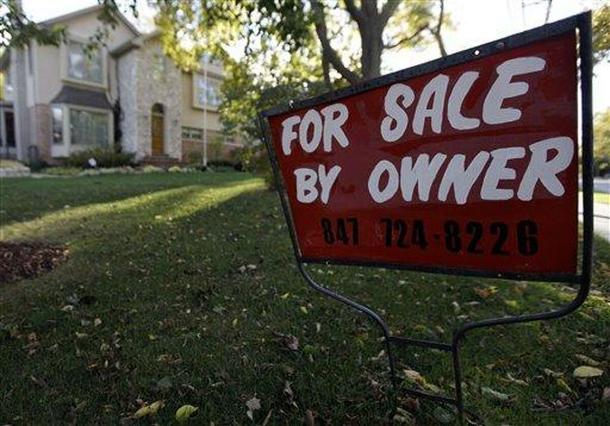 FILE - This Wednesday, Oct. 10, 2012 file photo shows a for-sale sign at a home in Glenview, Ill.An index measuring the number of Americans who signed contracts to buy homes in October jumped to nearly its highest level in almost six years. Steady job gains and record-low mortgage rates have made home buying more attractive. (AP Photo/Nam Y. Huh, File)