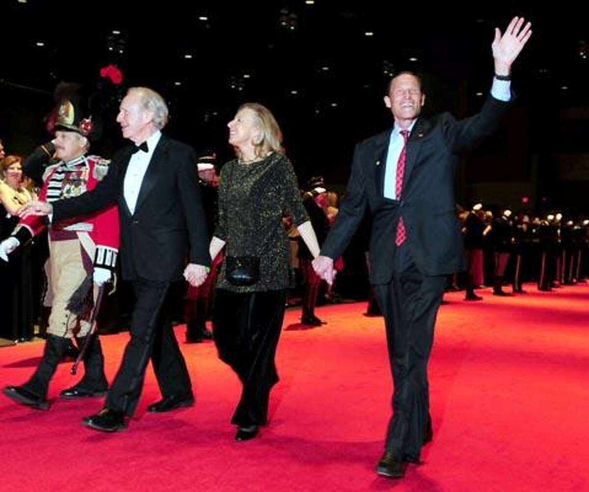 Senator Joseph Lieberman (left), his wife, Hadassah (center), and newly elected Senator Richard Blumenthal (right) enter the Inaugural Ball at the Connecticut Convention Center in Hartford with her husband, Michael Wyman (right), on 1/5/2011.Photo by Arnold Gold/New Haven Register AG0398B