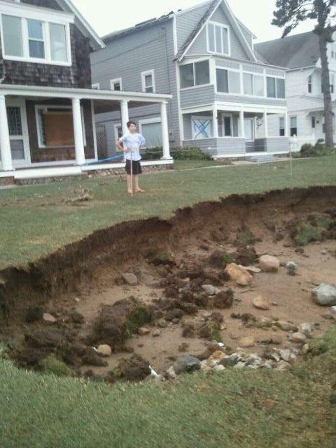 A sink hole in Westbrook's Stannard Beach area. Alexandra Sanders/Register