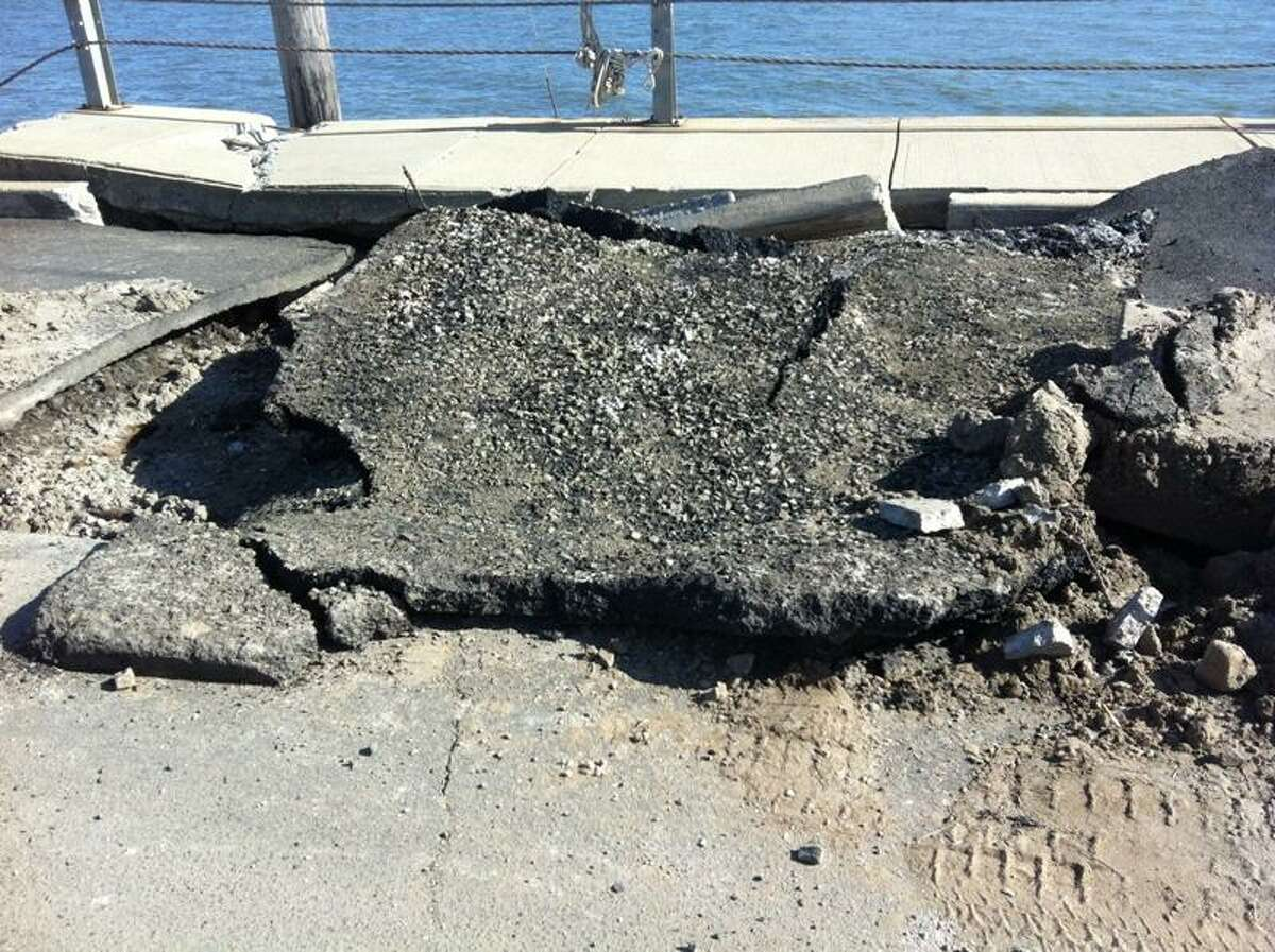 A sink hole on Middle Beach Road in Madison. Alexandra Sanders/Register