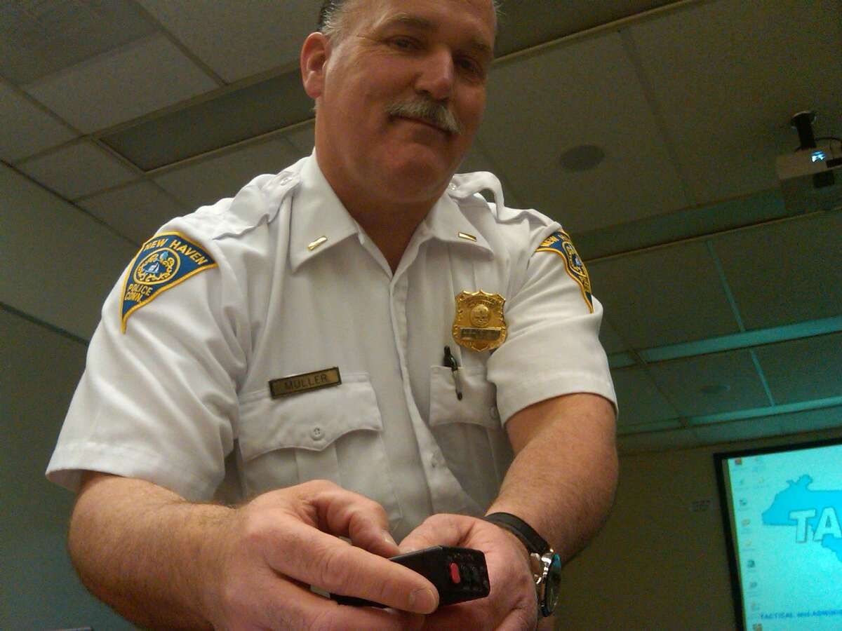Lt. Bob Muller displays the audio recorder, which is about the size of a pager Photo by William Kaempffer/Register