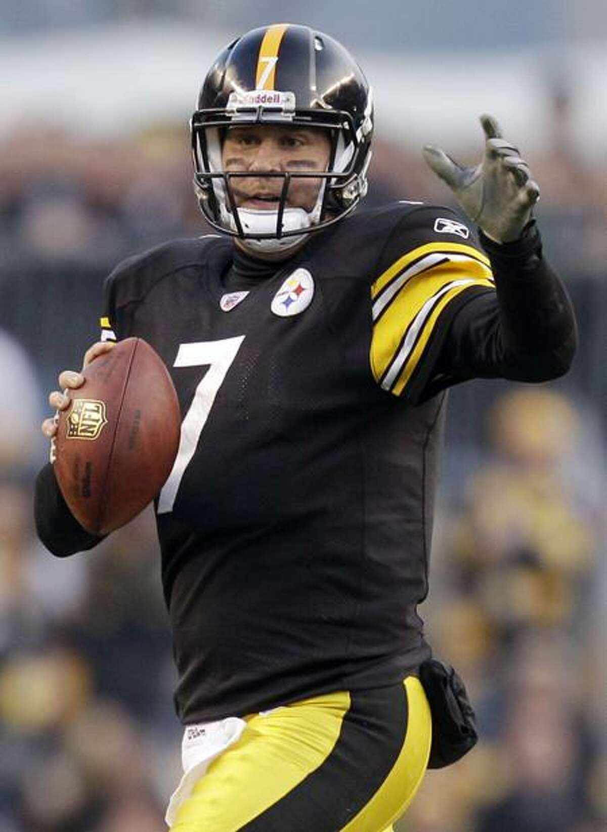 Pittsburgh Steelers quarterback Ben Roethlisberger (7) looks to pass against the New England Patriots during the second quarter of an NFL football game in Pittsburgh, Sunday, Oct. 30, 2011. (AP Photo/Gene J. Puskar)