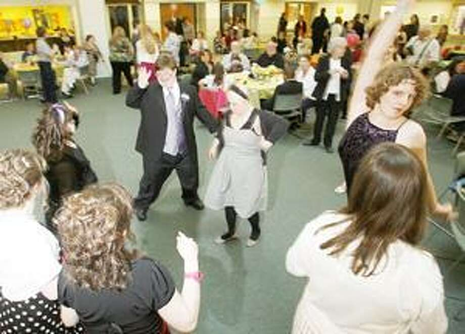 Dispatch Staff Photo by JOHN HAEGER Students and guests dance during the annual Spring Fling held at Madison Oneida BOCES in Verona on Friday, April 29, 2011.