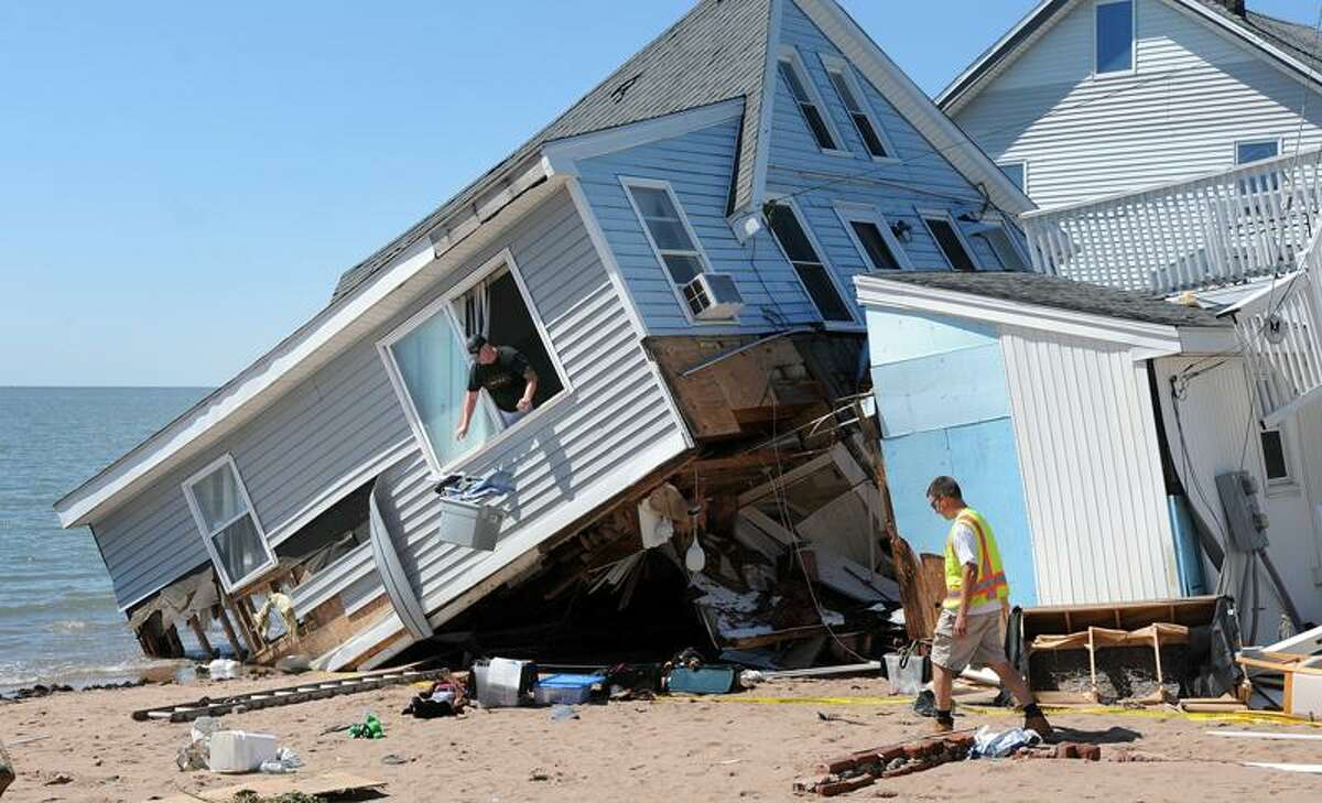 Residents retrieve valuables from their demolished homes on Cosey Beach Avenue in East Haven Monday. (Peter Casolino/Register)