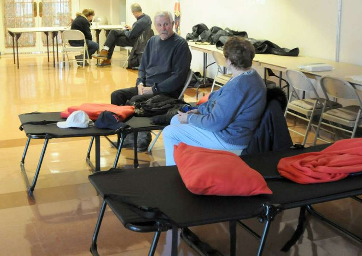 Frank Pawlow of Cheshire and his wife Louise, were among the early birds at a shelter set up at the Cheshire Senior Center Sunday afternoon. Peter Hvizdak / Register October 30, 2011 ph2397 Connecticut
