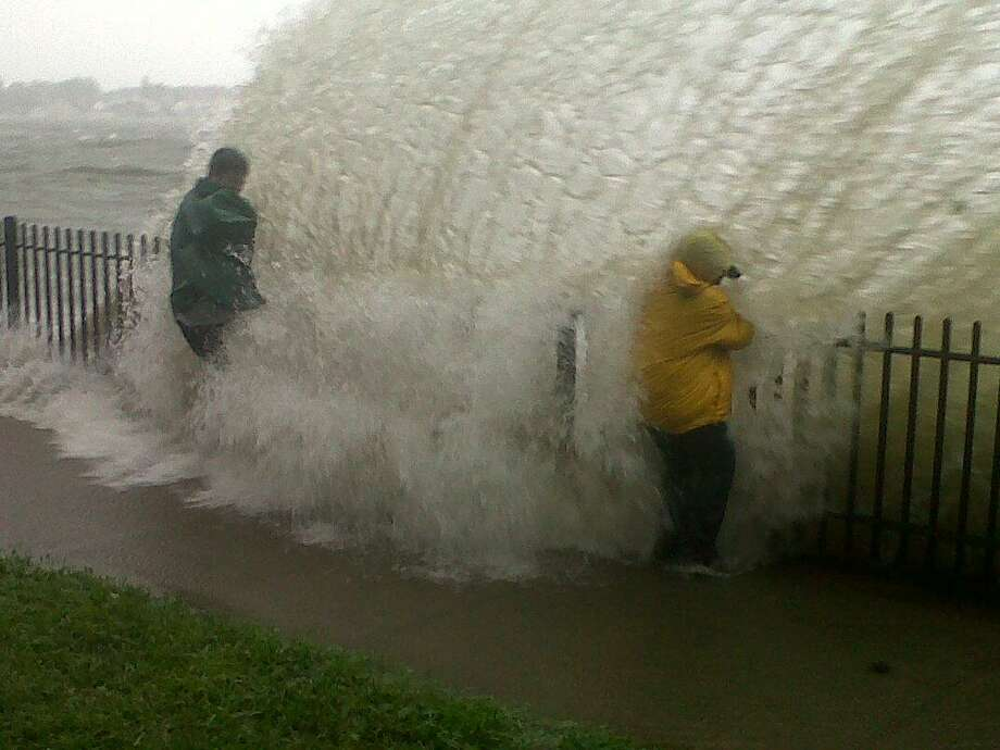 In this photo, residents get close to the impact of Irene at the sea wall in Morris Cove ibn New Haven, which had been evacuated before the storm hit