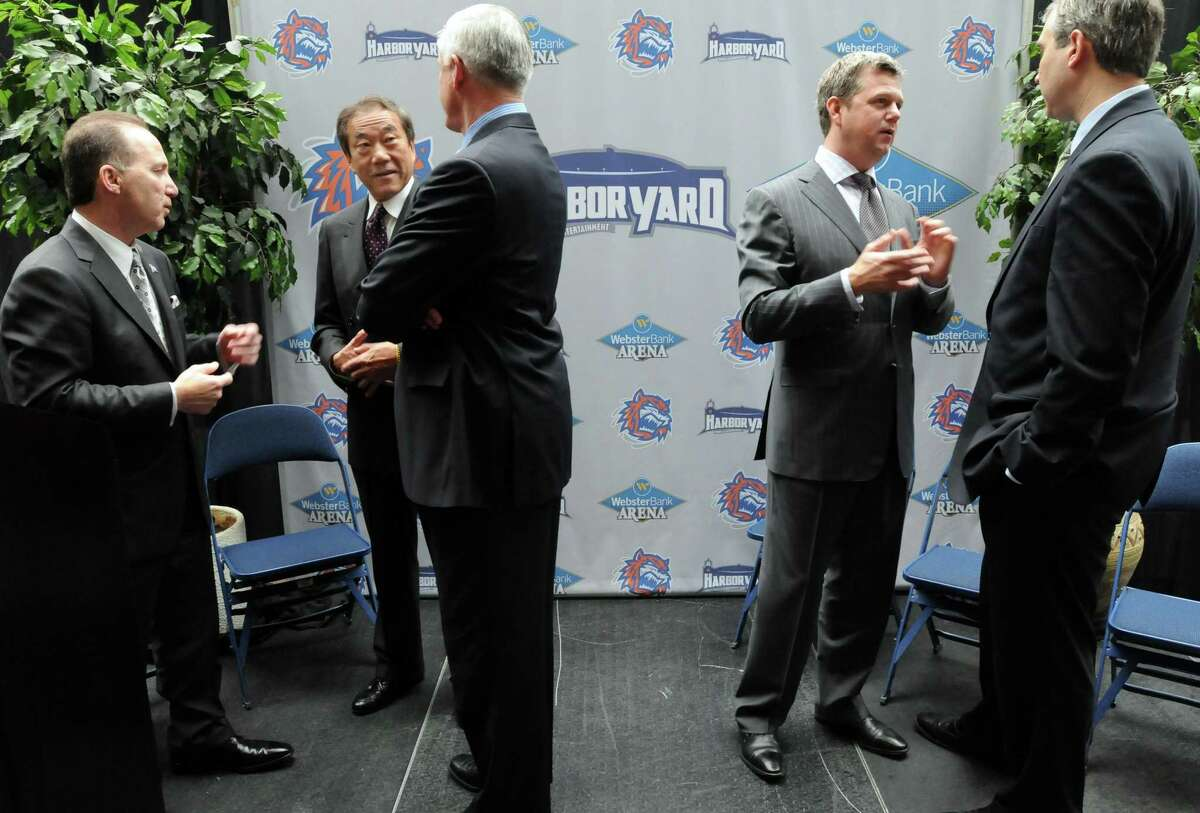 Those making the announcement that operations of the Arena have been assumed by Harbor Yard Sports & Entertainment LLC gather after a Thursday press conference: Sound Tigers team president Howard Saffan, NY Islanders owner Charles Wang, Bridgeport Mayor Bill Finch, Centerplate president and CEO Desmond Hague, and Webster Bank executive vice president John Ciulla. (Photo by Mara Lavitt/New Haven Register) 4/28/11