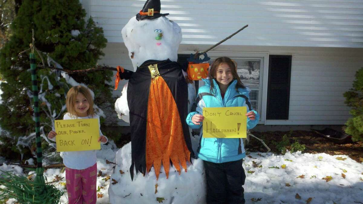 In this submitted photo: Morgan and Mia in Hamden building a snowman