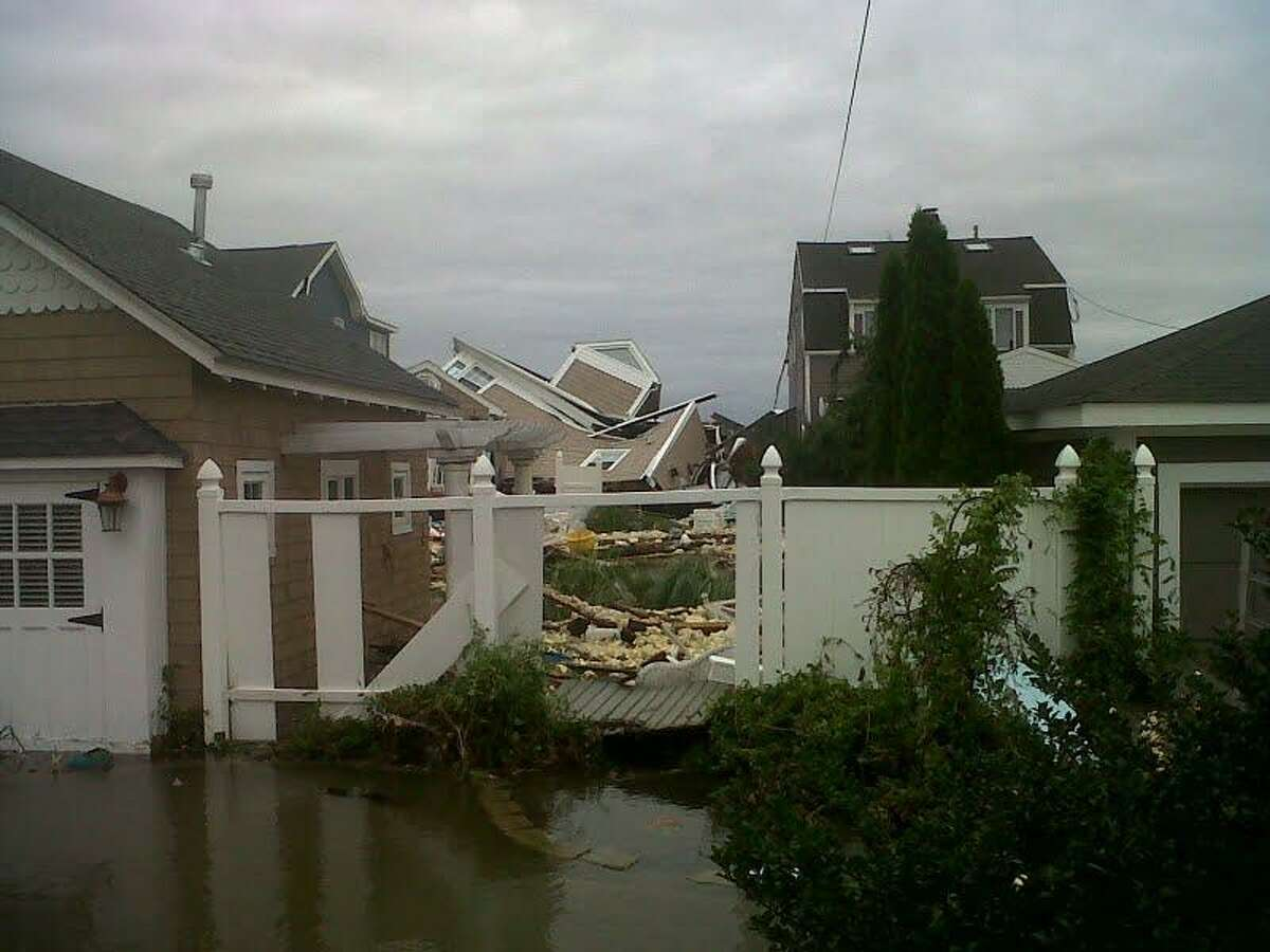 Damage to a house in East Haven's Cosey Beach section Photo by William Kaempffer