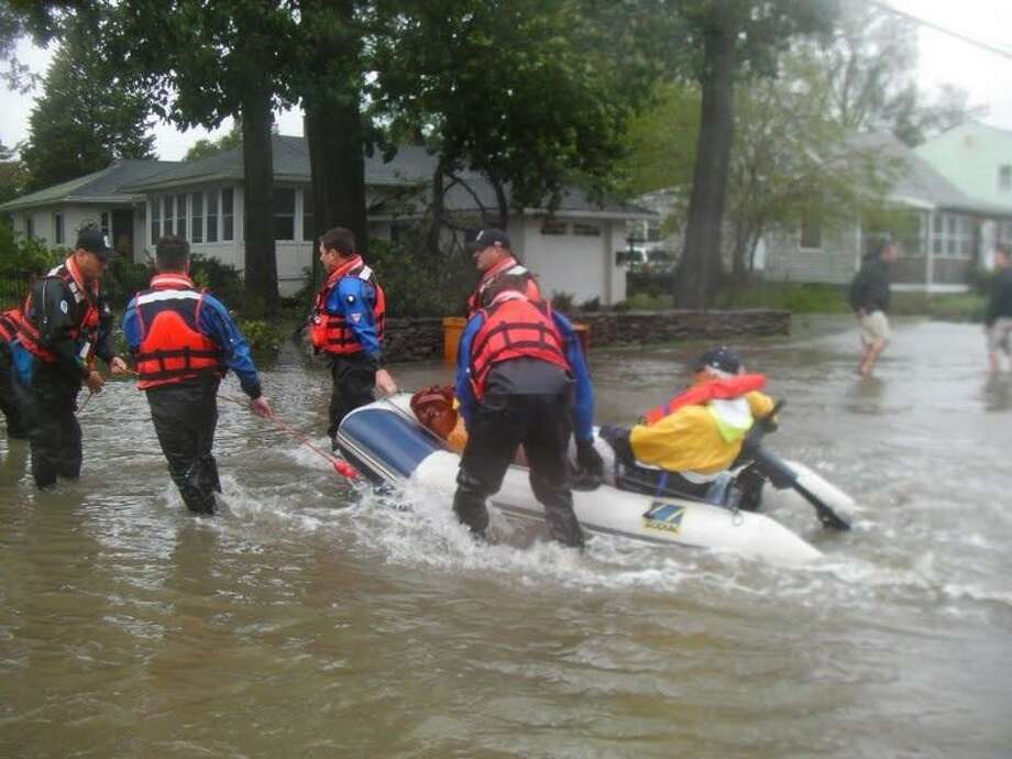 Milford authorities rescued a couple who were stranded in their home.