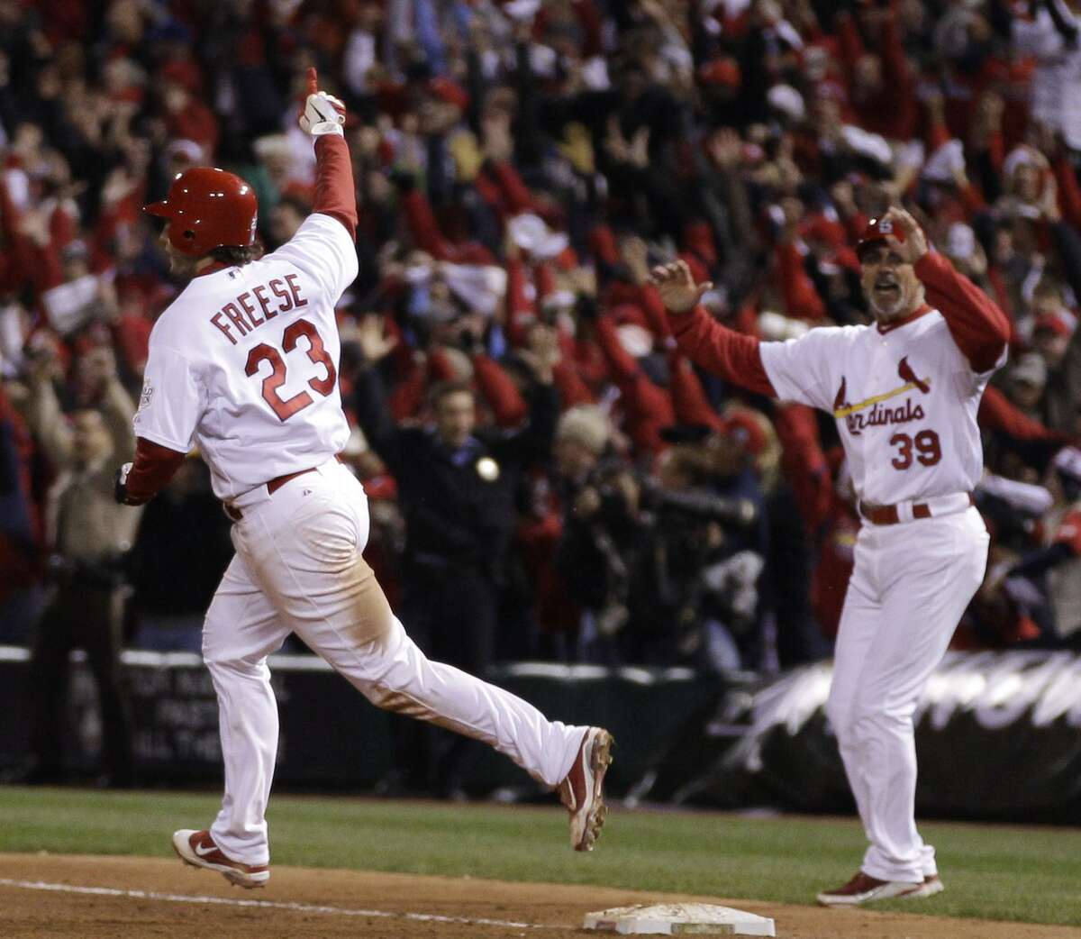 St. Louis Cardinals' David Freese (23) reacts after hitting a walk-off home run during the 11th inning of Game 6 of baseball's World Series against the Texas Rangers Thursday, Oct. 27, 2011, in St. Louis. The Cardinals won the game 10-9 to tie the series 3-3. (AP Photo/Matt Slocum)