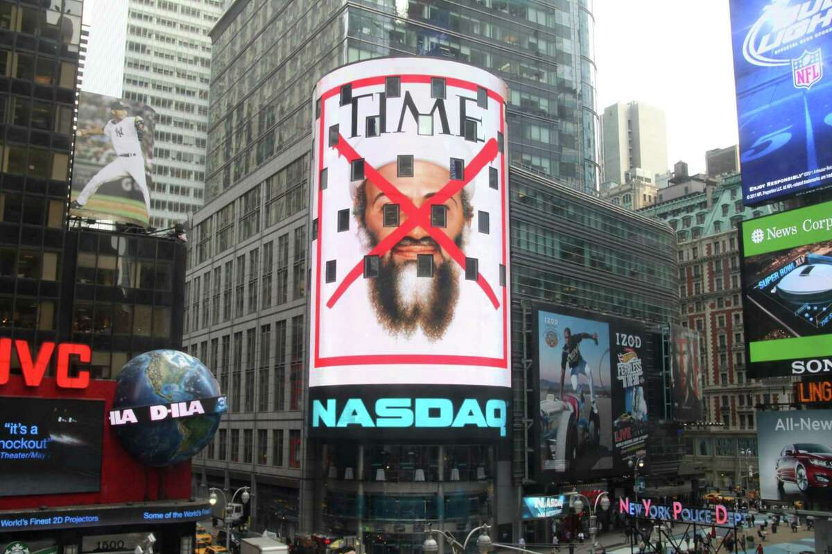 This Monday, May 2, 2011 photo, provided by NASDAQ OMX Group, shows the cover of a special issue of Time magazine on the death of Osama bin Laden displayed on the Nasdaq screen in New York's Times Square. The issue, featuring a red